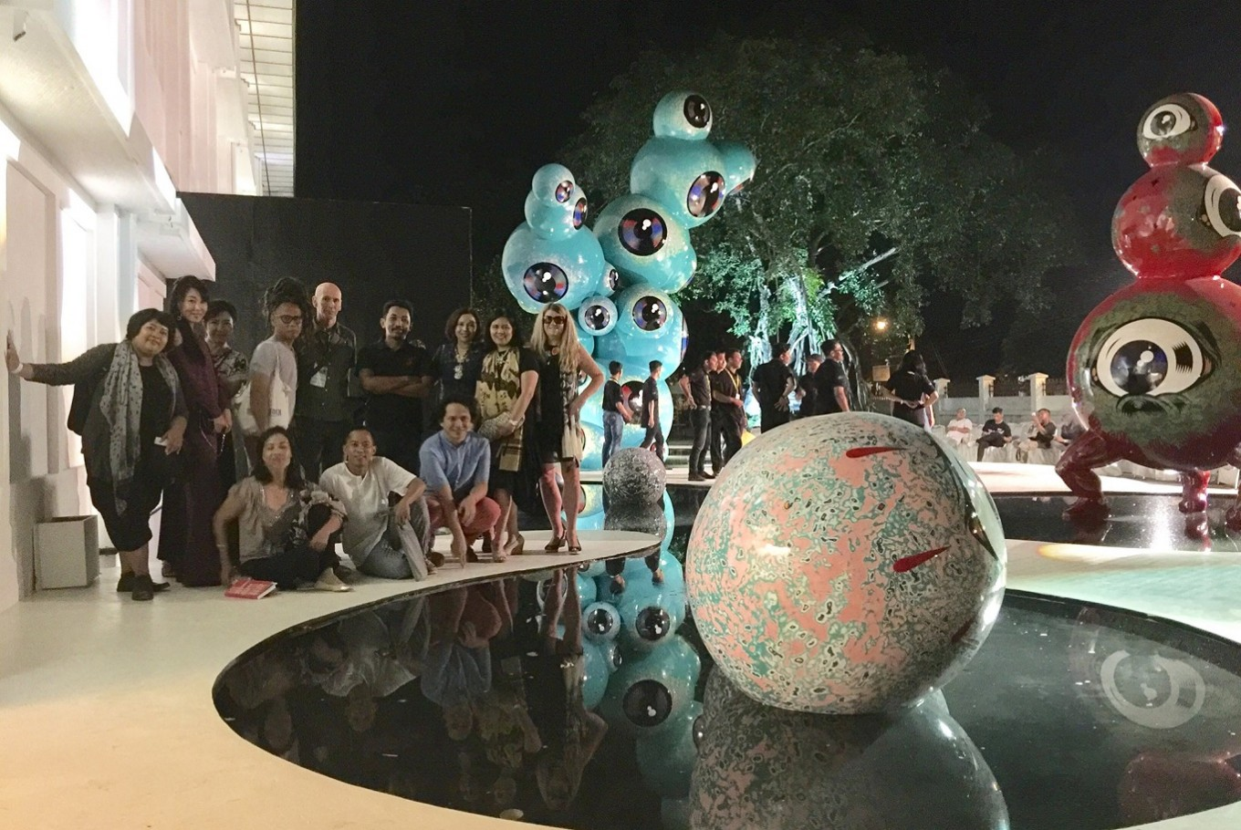 Indonesian artists, including Wedhar Riyadi, along with art lovers in front of Riyadi's 'Floating Eyes'.