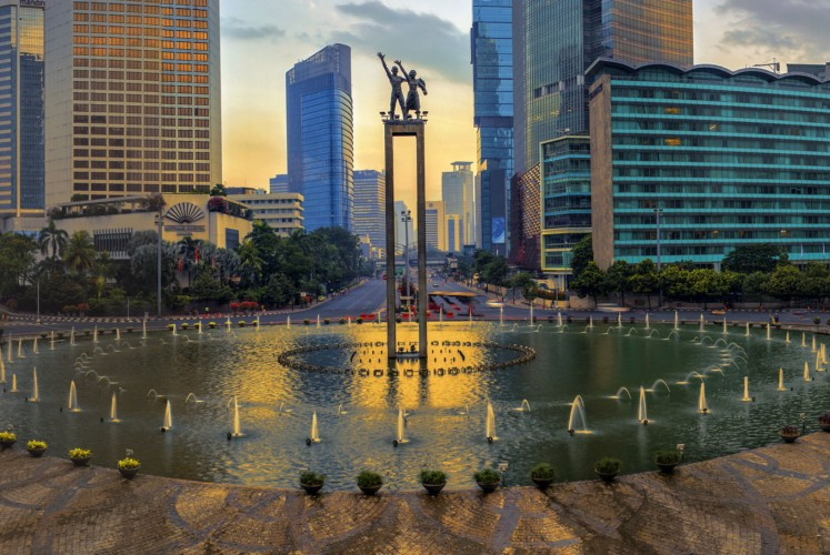 'Selamat Datang' Monument with Hotel Indonesia in the background.