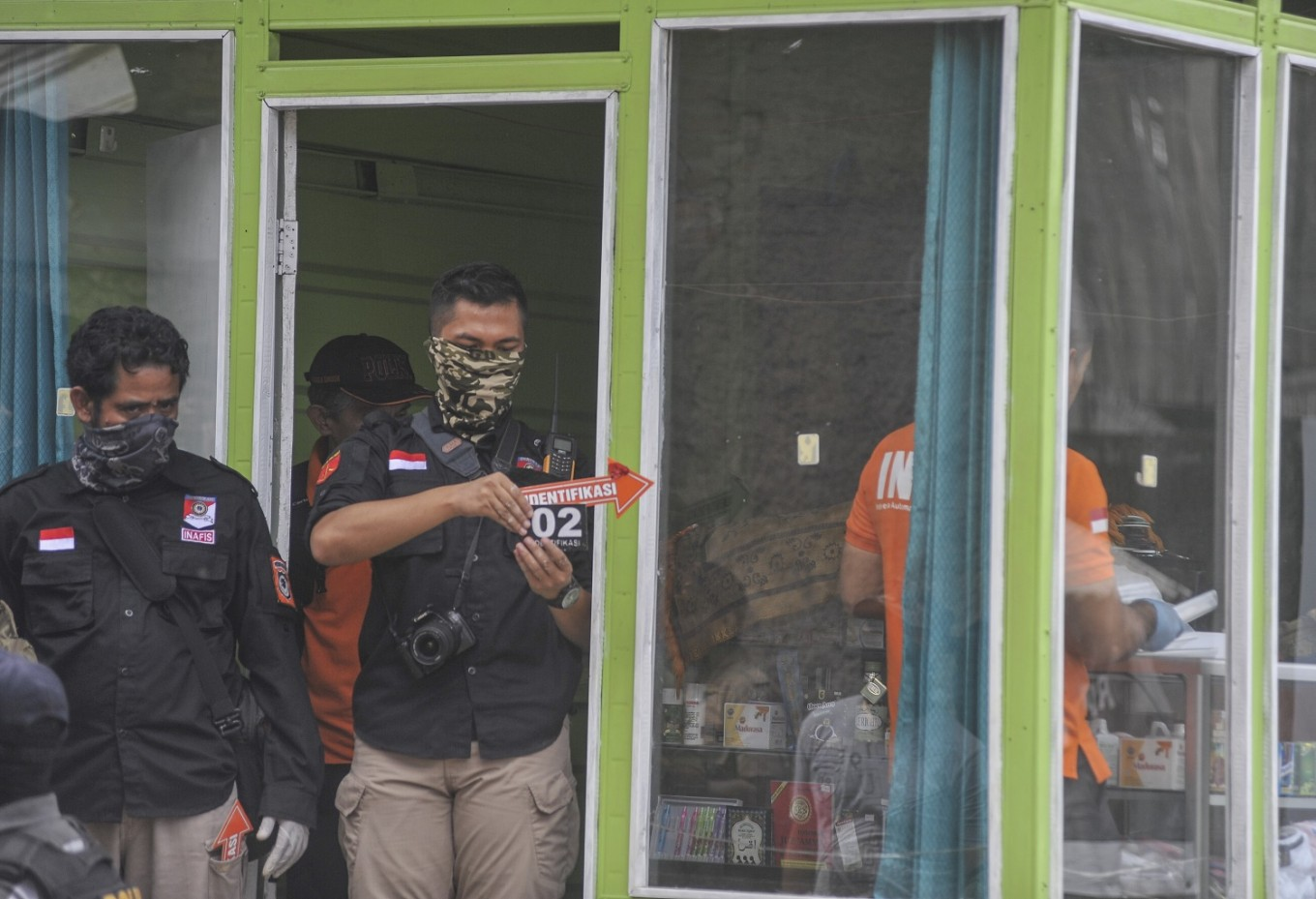 Densus 88 arrests two suspected terrorists linked to East Jakarta bombings