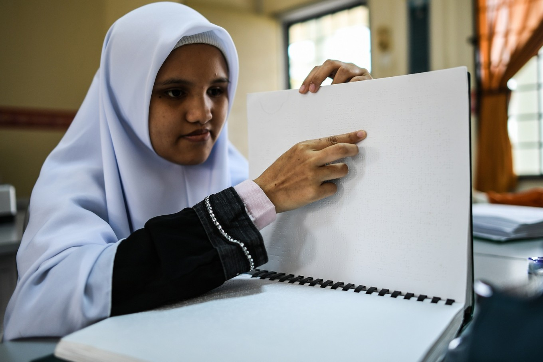 Blind Malaysian Muslims Study Quran Using Braille Art