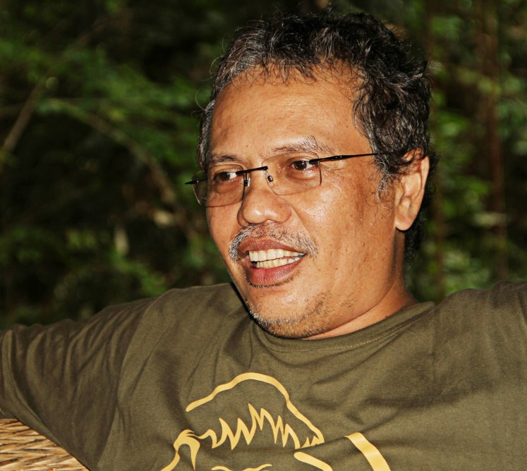 Conserving nature: Borneo Orangutan Survival Foundation (BOSF) CEO Jamartin Sihite explains orangutan conservation activities in Samboja Lestari, Kutai Kartanegara, East Kalimantan, on June 5.