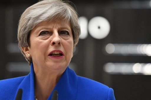 British PM defies critics and vows to govern