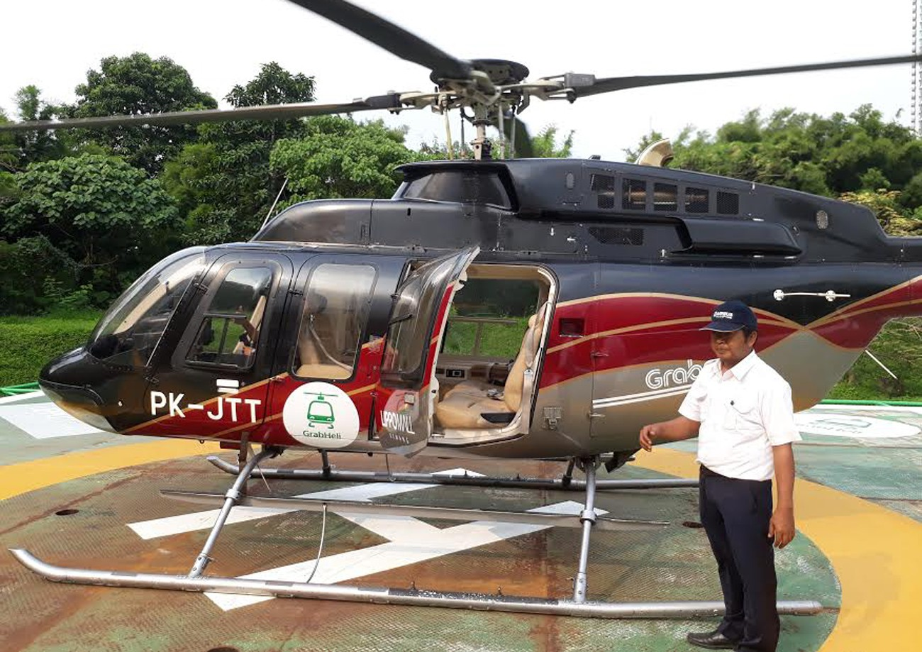 grab explores opportunities in helicopter service business the