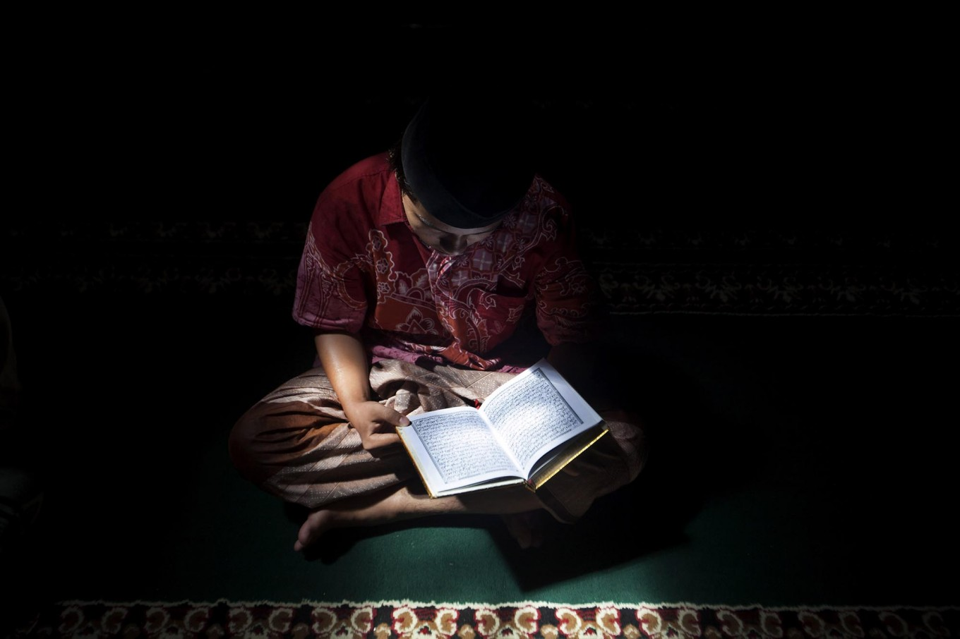 A student recites the Quran at the Lirboyo mosque. It is a routine activity for students at the boarding school. JP/Sigit Pamungkas