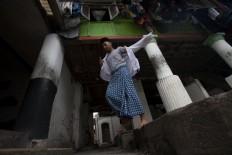 A student walks to the mosque. JP/Sigit Pamungkas