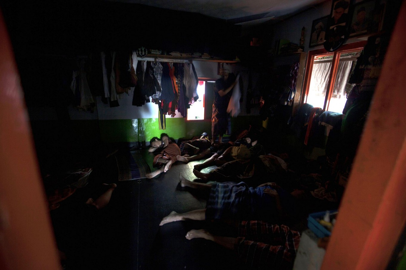 Students sleep without mattresses and have to cramp into a room. Sometimes they take turns to sleep because of limited space. JP/Sigit Pamungkas