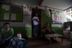 The atmosphere in front of a student's room. Some of them rest while others prepare to recite the Quran. JP/Sigit Pamungkas
