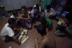 Students share food and drinks when breaking the fast. JP/Sigit Pamungkas