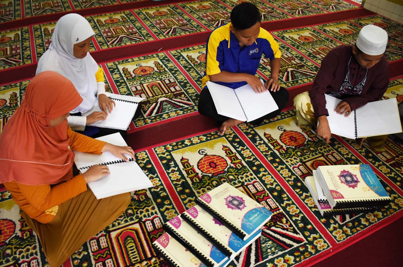 Blind worshipers learn to read the Quran in braille at An Nur Mosque in the Rehabilitation Center for the Blind in Janti, Malang, East Java. JP/Aman Rochman