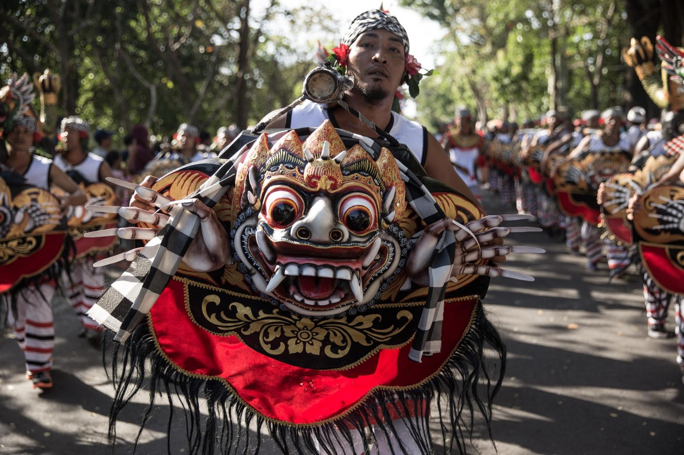 Balinese artists perform the Okokan dance during the opening of the 39th Bali Art Festival at the Bajra Sandhi Monument in Denpasar. JP/Agung Parameswara