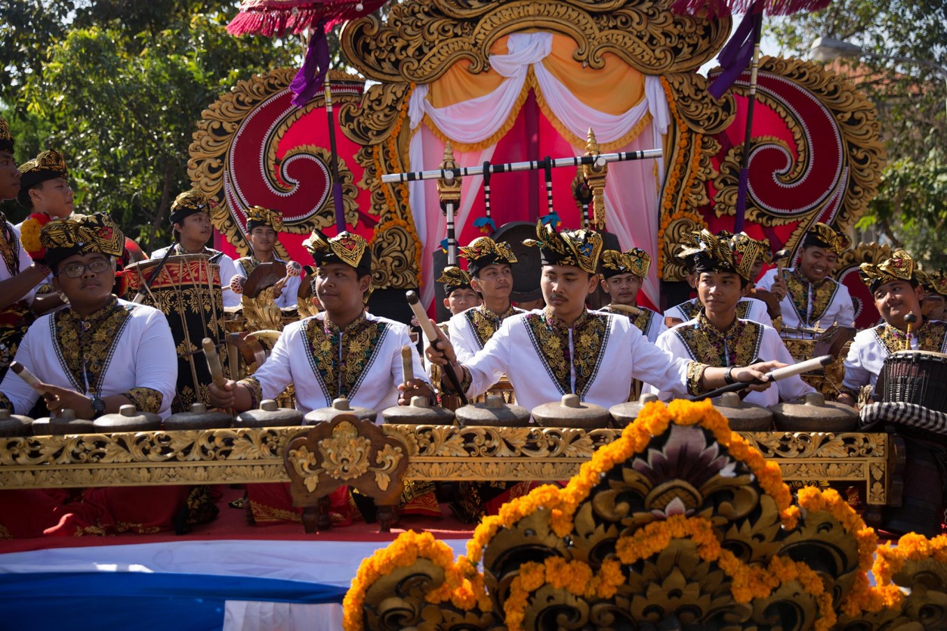 Young Balinese men play in a gambean (Balinese orchestra) during the opening of the 39th Bali Art Festival at the Bajra Sandhi Monument in Denpasar. JP/Agung Parameswara