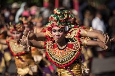 Balinese artists perform during the opening of the 39th Bali Art Festival at the Bajra Sandhi Monument in Denpasar. JP/Agung Parameswara
