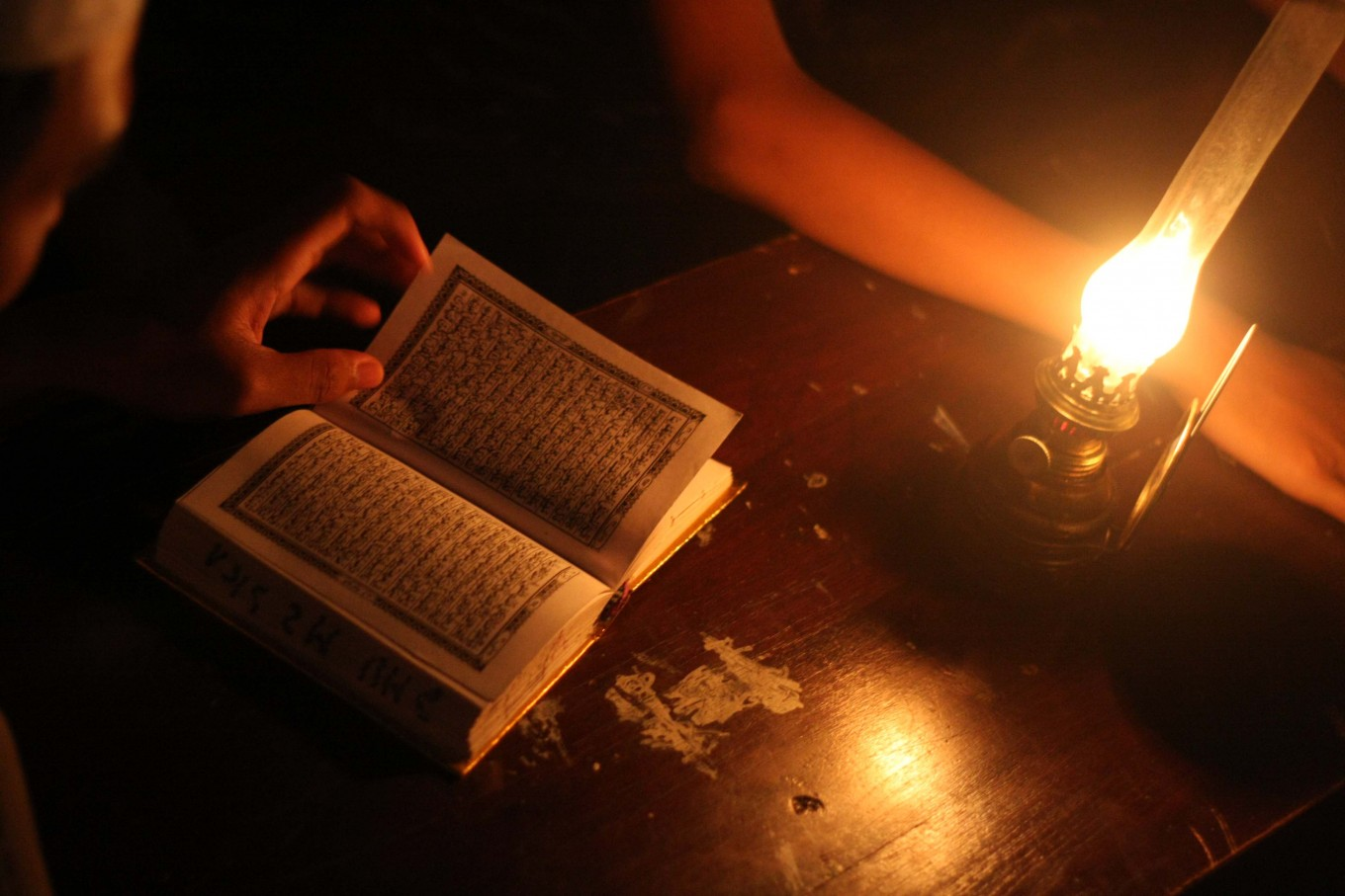 A student recites the Quran outdoors with an oil lamp at Mojosongo, Surakarta, Central Java, on June 11. JP/Maksum Nur Fauzan