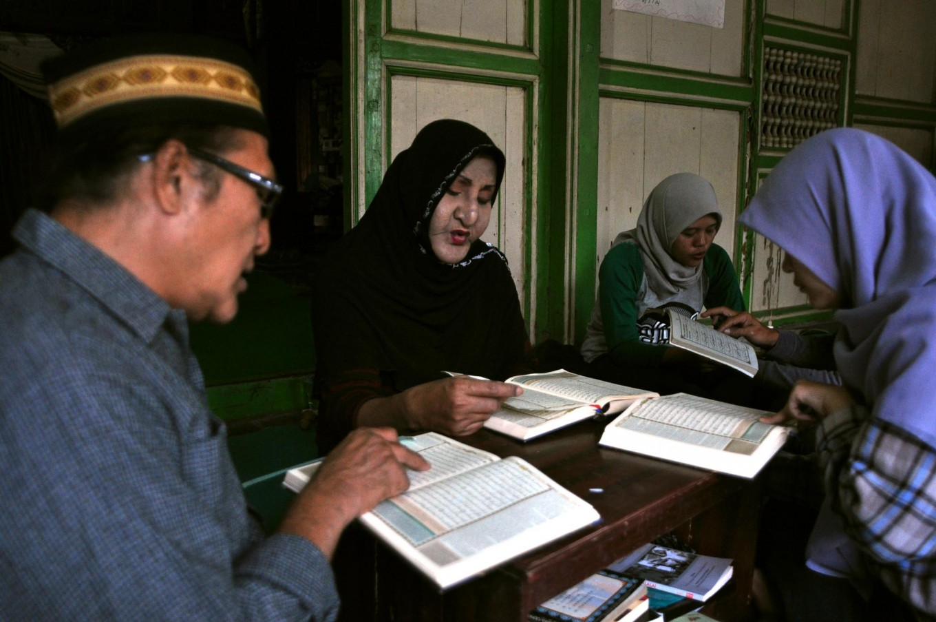 Shinta Ratri, 55, the leader of Al Fatah Islamic boarding school, recites verse Al Hud 71-88 of the Quran. There are 46 transgender students in the boarding school but only 26 students are active during the Ramadhan fasting month. JP/Magnus Hendratmo