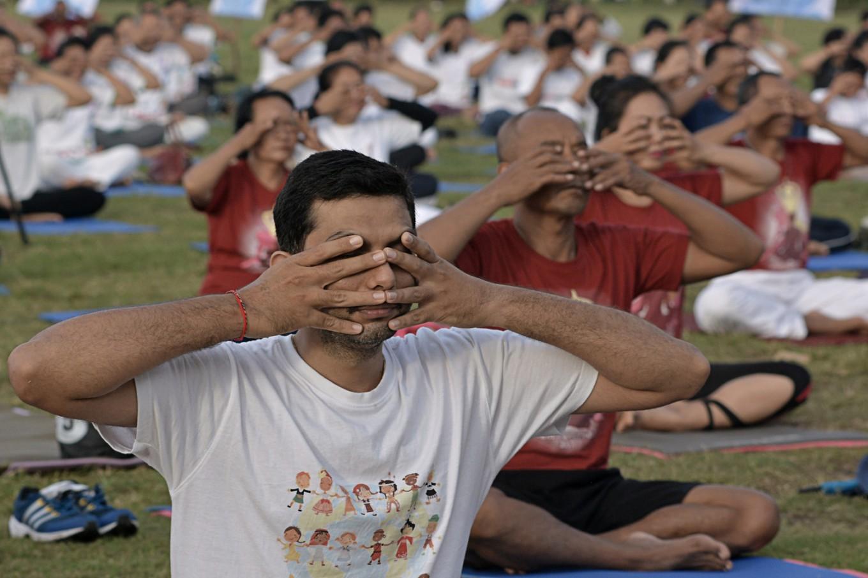 WHO calls for better health through yoga