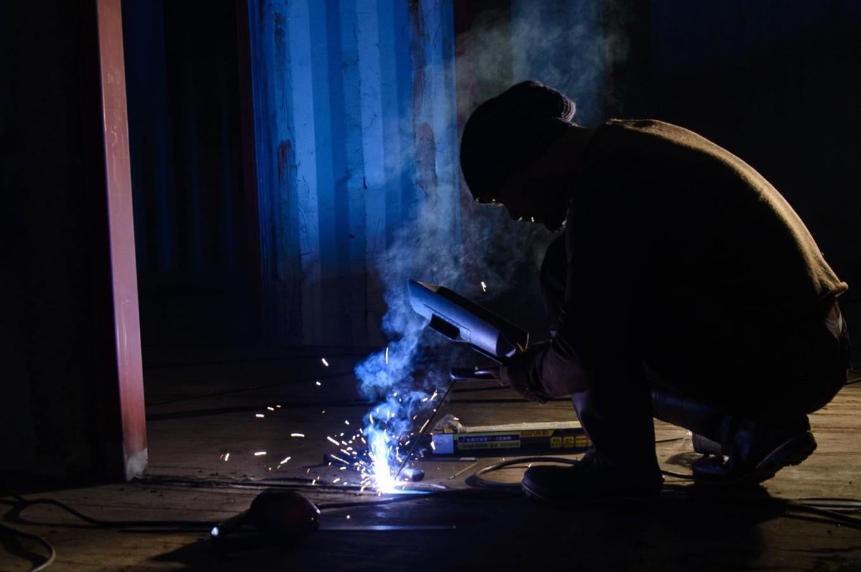 Rustono welds an iron to build his new factory. JP/Tarko Sudiarno