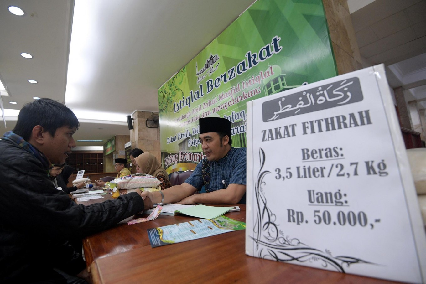 Controversy over 'zakat' plan shows lack of trust