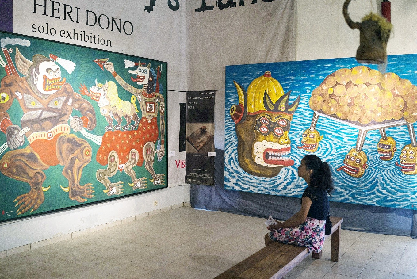 Viewing art: A visitor contemplates a solo exhibition by artist Heri Dono at his studio in Yogyakarta.