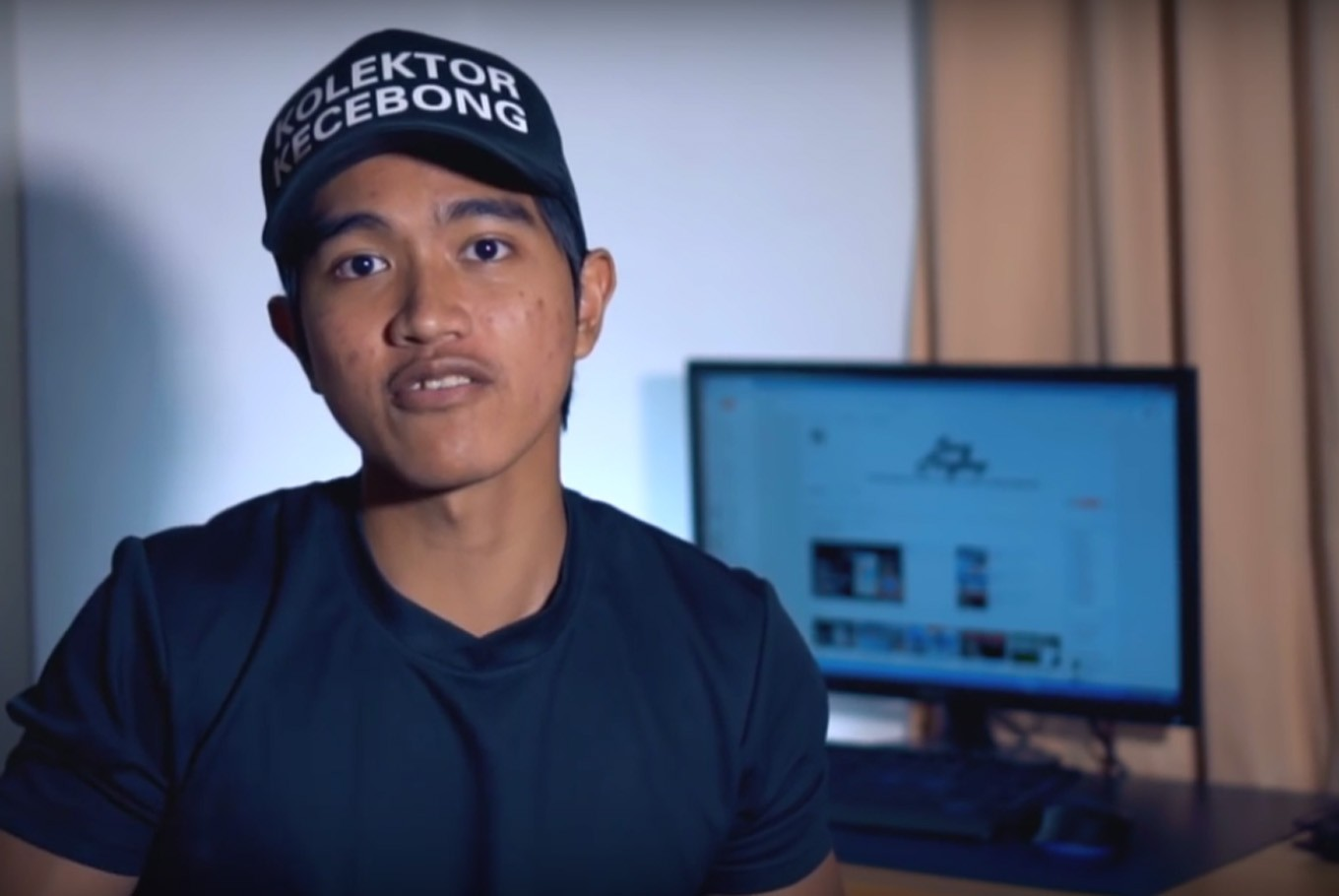 Police detain man who reported Jokowi's son