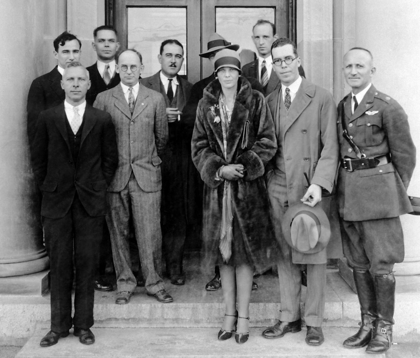 This November 1928 file photo released by NASA shows front row (L-R) E.A. Meyers, Elton Miller, Amelia Earhart, Henry Reid, and Lt. Col. Jacob W.S. Wuest. Back row (L-R) Carlton Kemper, Raymond Sharp, Thomas Carroll, (unknown person behind Earhart), and Fred Weick,during her tour of Langley in Virginia.