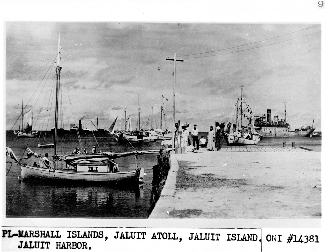 In this photo released by the US National Archives and received by AFP on July 6, 2017, shows a group of people standing on a dock in the 1930's, one that may be Amelia Earhart, on the Jaluit Atoll, Marshall islands.