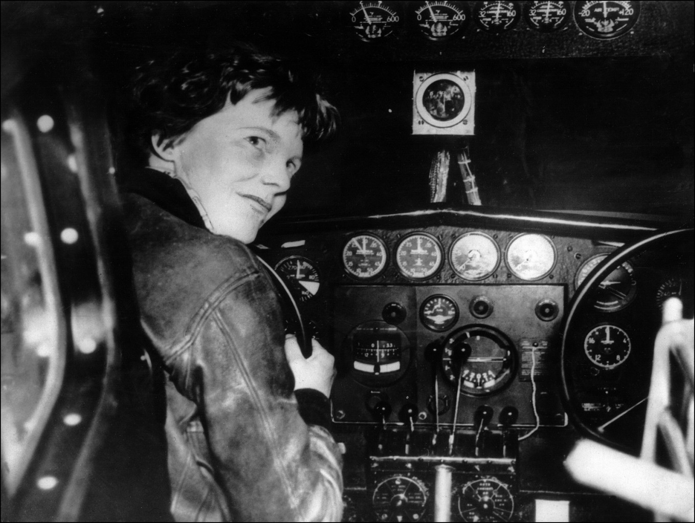 An undated 1930's file photo shows US aviator Amelia Earhart looking through the cockpit window of an aircraft in Essonne, France.
