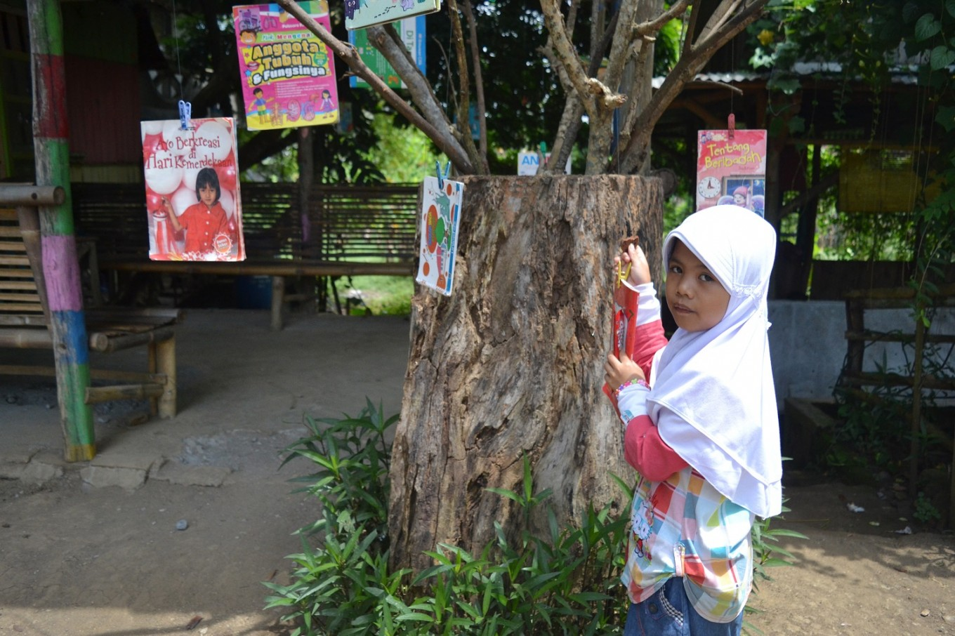 """""""One Book One Day"""" is among the educational programs at Sekolah Alam Bengawan Solo's library."""
