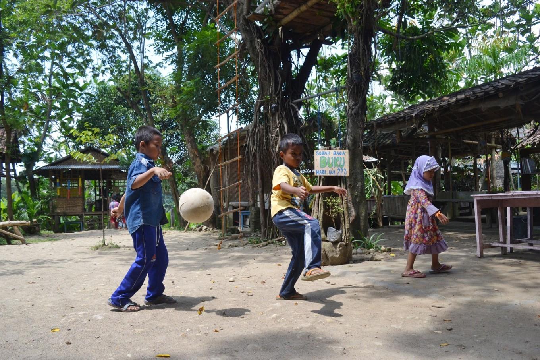 Students playing soccer in Sekolah Alam Bengawan Solo.