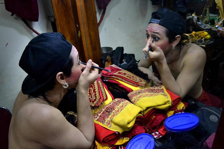 An actor applies make-up before the Wayang Orang Sriwedari anniversary show.