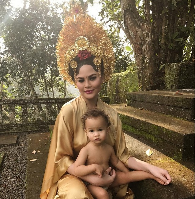 Teigen also shared her photo while wearing this all-gold outfit and holding daughter Luna in her lap.