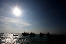 A convoy of boats during the Lomban Festival in Jepara Bay, Central Java, on July 2. JP/Maksum Nur Fauzan