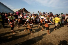 A group of dancers perform as part of the Lomban Festival on Kartini Beach, Jepara, Central Java, on July 2. JP/Maksum Nur Fauzan