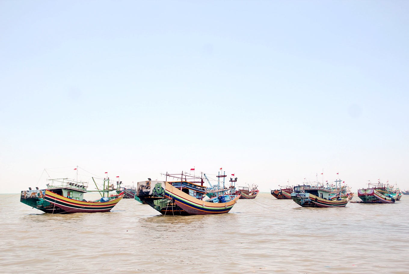 Business as usual: Wooden vessels anchor in the waters off Juwana in Pati, Central Java.