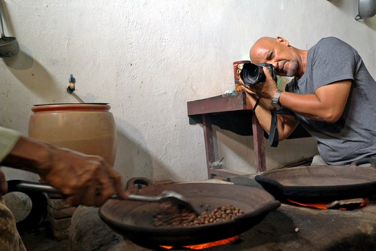 Documenting: Rio Helmi takes a photo of local coffee maker.