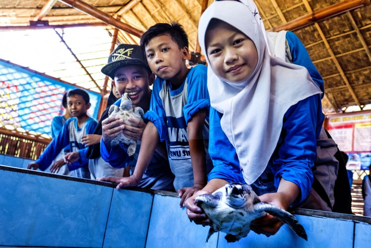 Save the turtles: School children at the Pantai Cemara conservation project.
