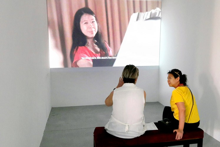 Interaction: A visitor discusses with artist Tintin Wulia her video 1001 Martian Homes at the Indonesian pavilion during the Venice Art Biennale 2017.