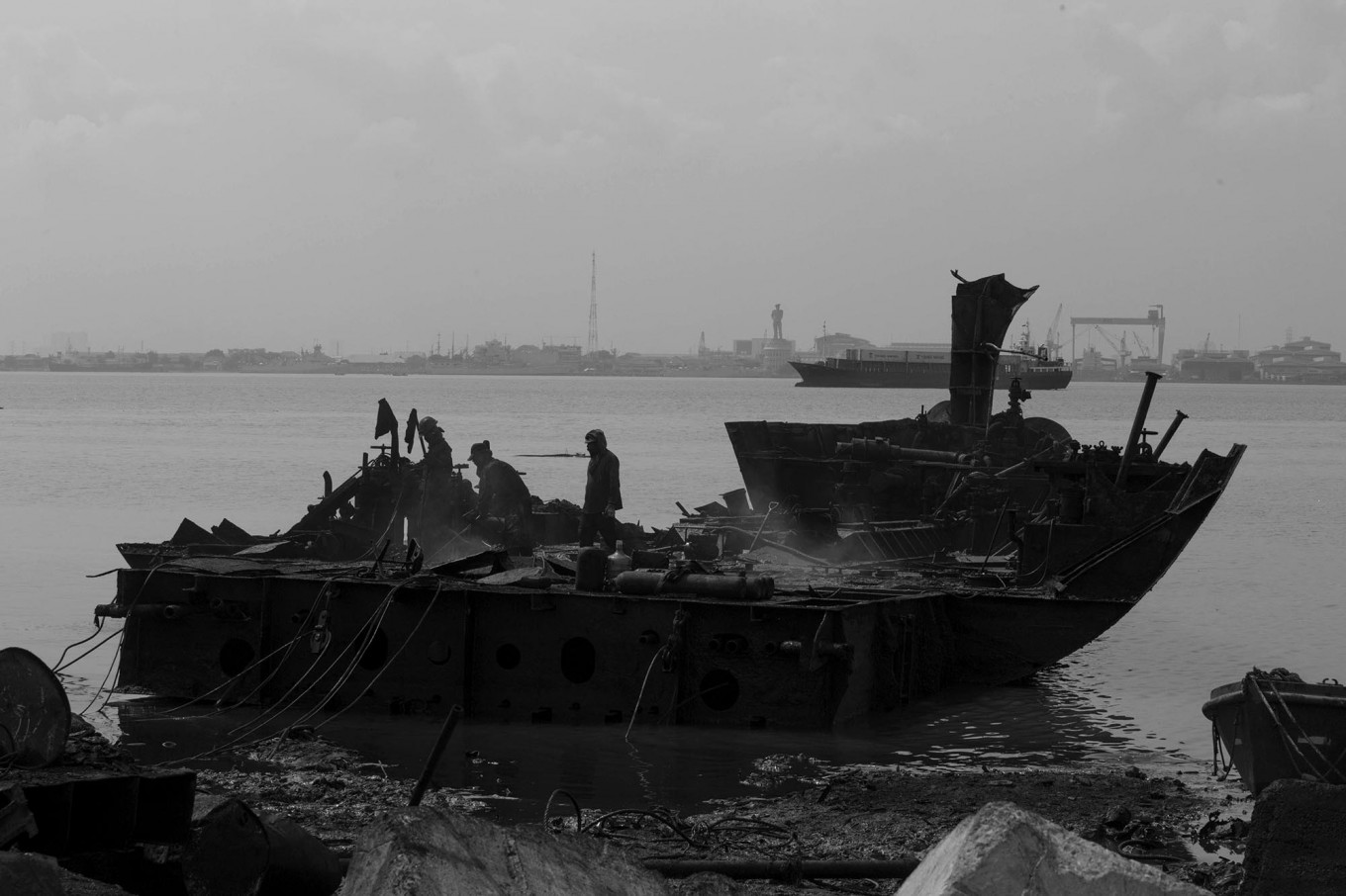 Three workers cut the hull of a ship. JP/Sigit Pamungkas