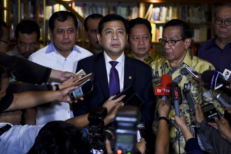 Suspect: Golkar Party chairman Setya Novanto (center) gives a statement to the press after meeting with Golkar's ethics council chairman BJ Habibie in Jakarta on July 24.