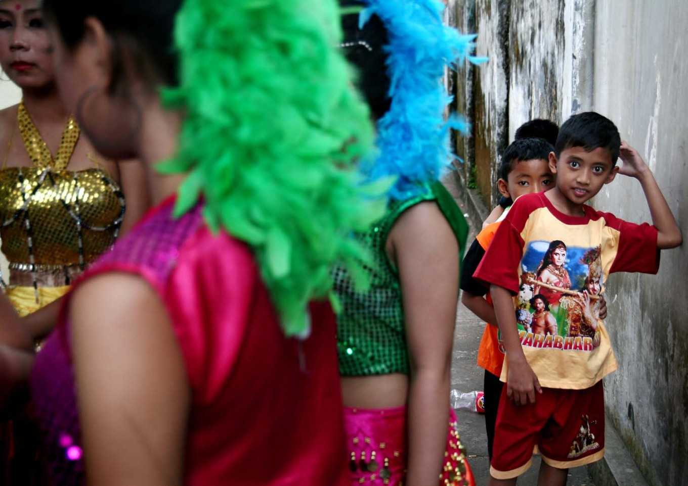 Some boys watch female dancers gear up for their turn to perform. JP/Aman Rochman
