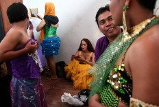 Transgender members put on their makeup and costumes for a stage play during the festival. JP/Aman Rochman