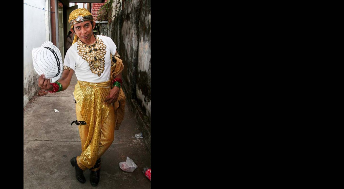 Nustain, 48, from Jakarta, poses with friends before the festival begins. JP/Aman Rochman