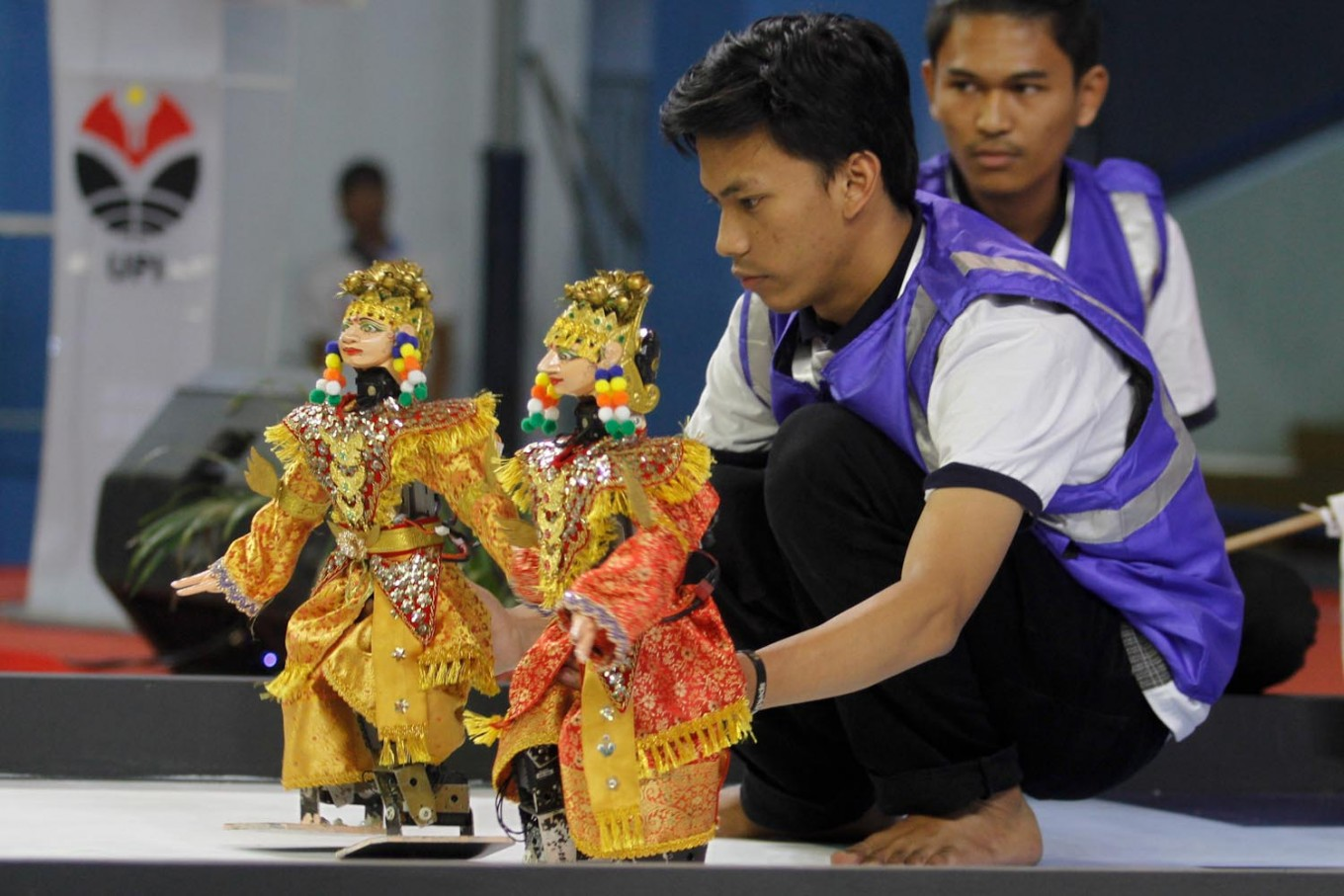 A participant prepares his robots for the traditional dance category during the competition. JP/Arya Dipa