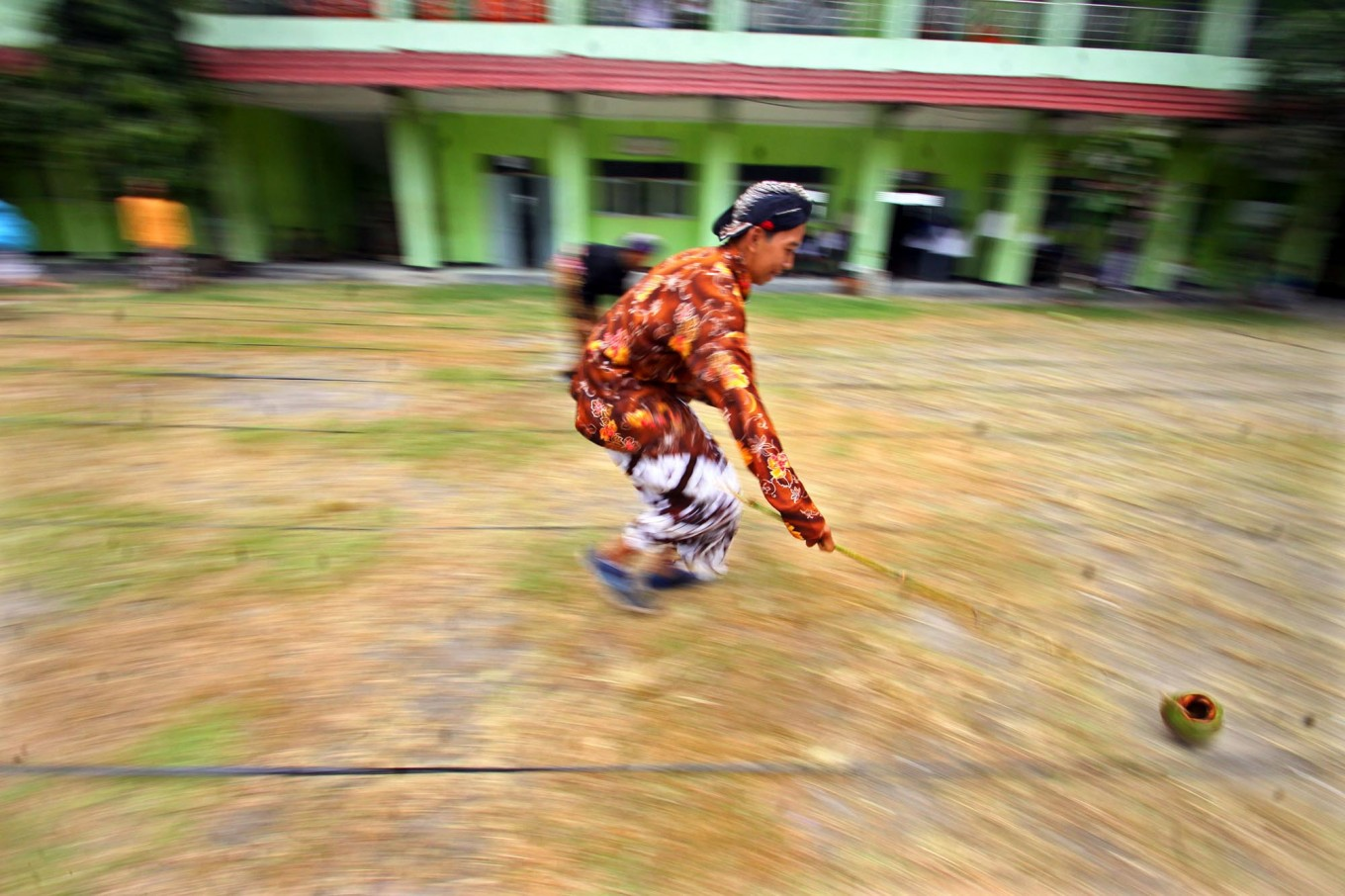 A new student of SMK 1 Pundong state vocational high school in Bantul regency, Yogyakarta, runs during the cengkir (coconut shell) race during the school orientation program on Wednesday, July 19, 2017. JP/Aditya Sagita