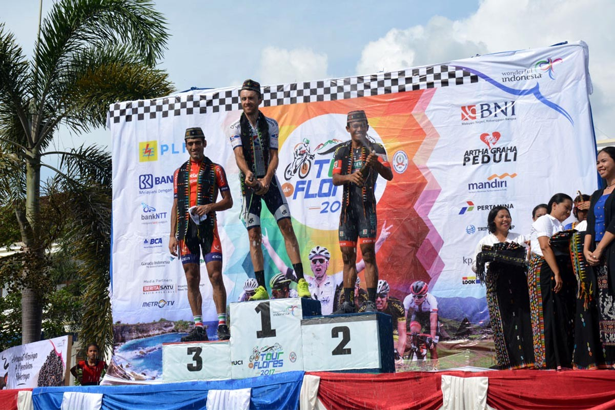 Thomas Lebas of France, who races for Japanese Kinan Cycling team, celebrates atop the podium after winning the sixth stage of the Tour de Flores in Labuan Bajo while Iranian Arvin Moazambigodarzi (right) from Iran's Pishgaman Cycling finished as the runner-up and Filipino Marcelo Felipe (left) of the Philippines 7 Eleven Cycling Team finished third on July 23, 2017. JP/Markus Makur