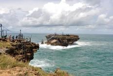 The view of Timang islet in Gunung Kidul regency, Yogyakarta. Tourists must brace themselves to cross the strait. JP/Magnus Hendratmo