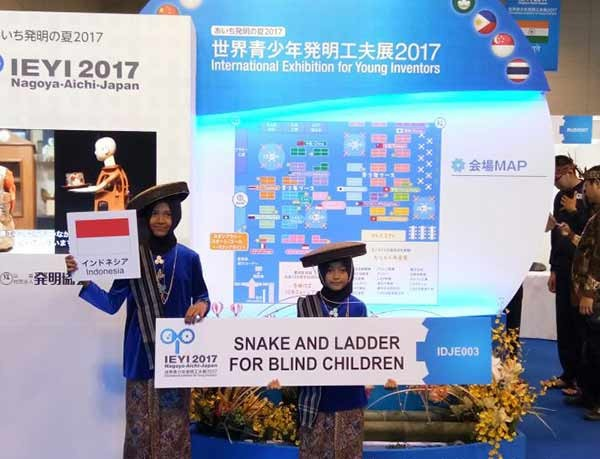 Elementary school students of IT Bina Amal in Semarang, Central Java, Hanun Dzatirrajwa and Izza Aulia Putri Purwanto, win silver medal and special award from the official Technopol Moscow in Russia for their creation 'Snake and Ladder for Blind Children'.