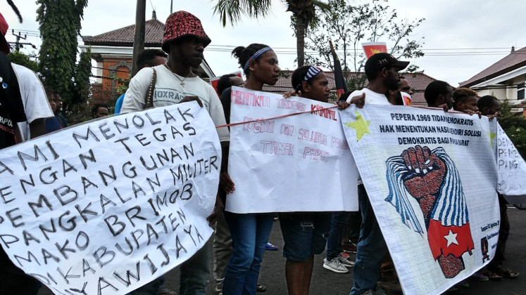 United: Around 30 students of the Papua Student Alliance Bali hold a rally in Denpasar on Aug. 2.