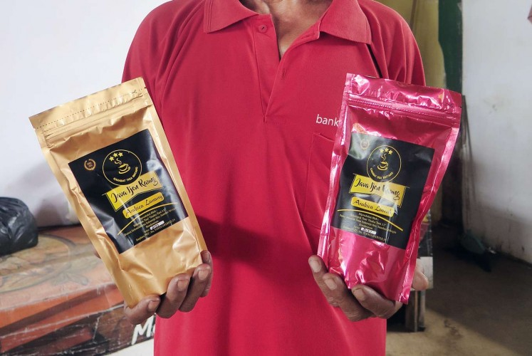 Bondowoso's pride: Muali holds two variants of Bondowoso's Java Ijen Raung coffee.