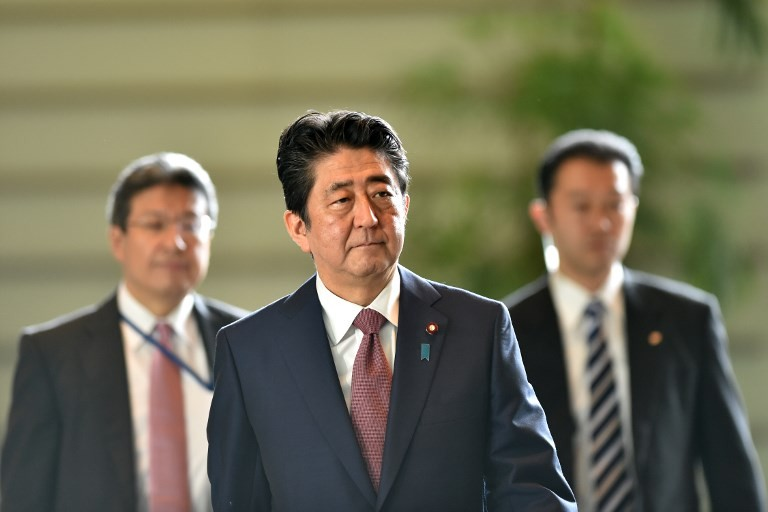 Japan PM Abe names new defence, foreign ministers in cabinet revamp