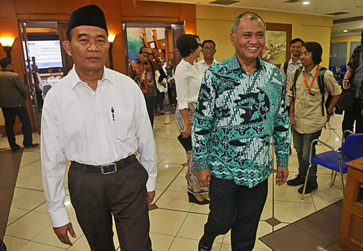 Education and Culture Minister Muhadjir Effendy (left) walks with Corruption Eradication Commission (KPK) chairman Agus Rahardjo after the signing of a Memorandum of Understanding (MoU) at the Education and Culture Ministry in Jakarta, on Thursday, Aug. 3, 2017.